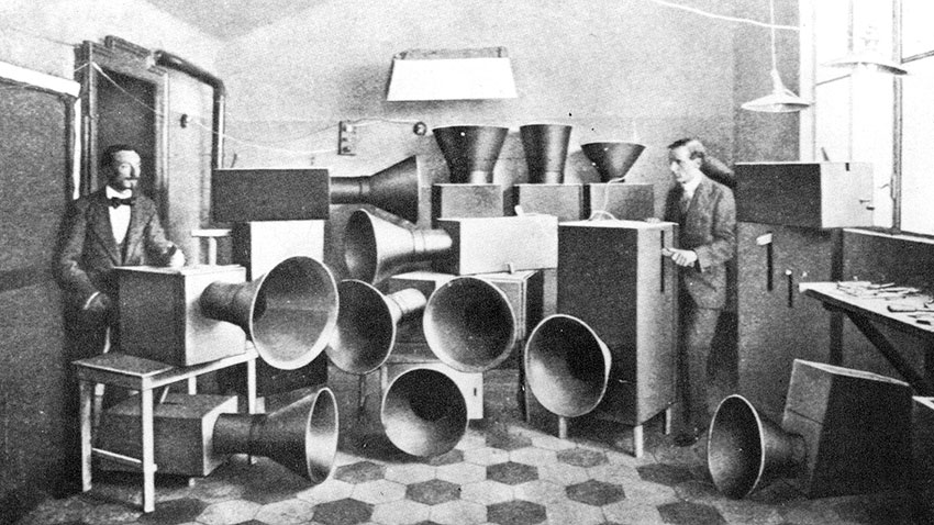 "Ugo Piatti with Russolo and his intonorumori in his Milan laboratory.  January 1, 1913. Reproduced in L'Arte dei rumori (Milan: Edizione Futuriste di ""Poesia,"" 1916)"